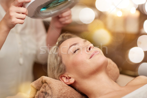 Stock photo: close up of young woman lying in spa