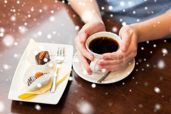 close up of woman holding coffee cup and dessert Stock photo © dolgachov