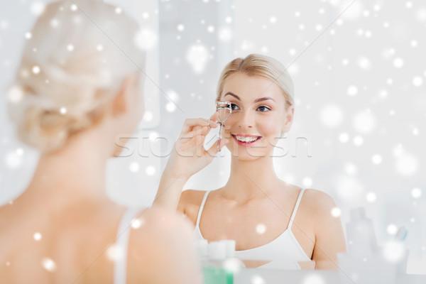 Donna ciglia bagno bellezza compongono cosmetici Foto d'archivio © dolgachov