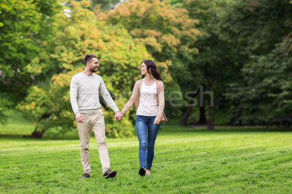 Stock photo: happy couple walking in summer park