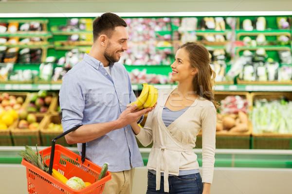 happy couple buying bananas at grocery store Stock photo © dolgachov