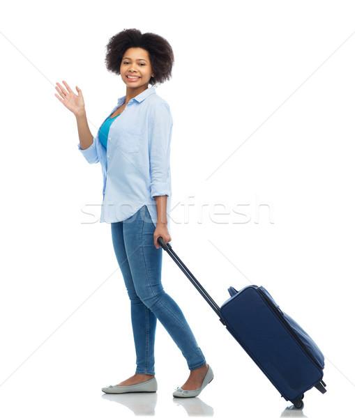 happy woman with travel bag waving hand Stock photo © dolgachov