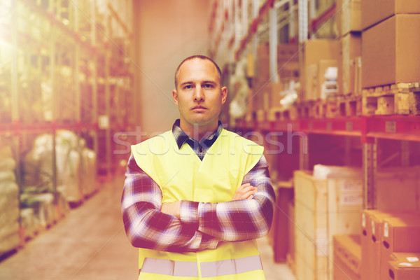 man in reflective safety vest at warehouse Stock photo © dolgachov