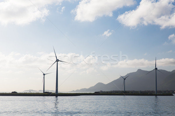 turbines at wind farm on sea shore Stock photo © dolgachov