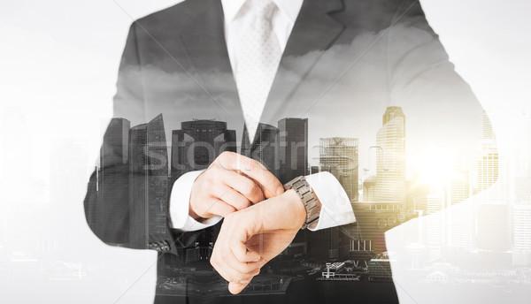 close up of businessman with wristwatch Stock photo © dolgachov