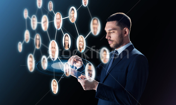 businessman with tablet pc and contacts network Stock photo © dolgachov