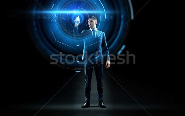 businessman in suit touching virtual projection Stock photo © dolgachov