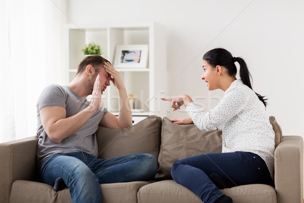 unhappy couple having argument at home Stock photo © dolgachov