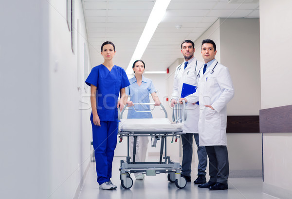 group of doctors with gurney at hospital Stock photo © dolgachov
