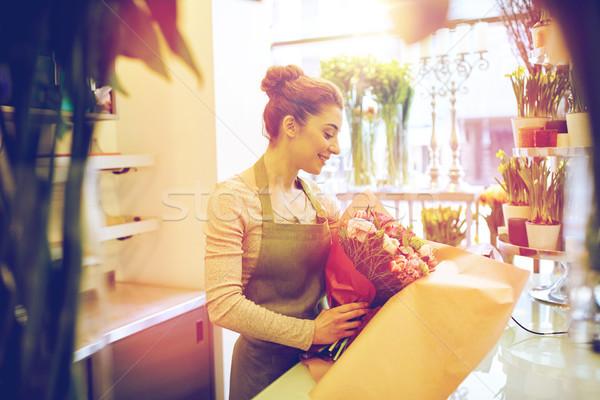 笑みを浮かべて 花屋 女性 花屋 ストックフォト © dolgachov