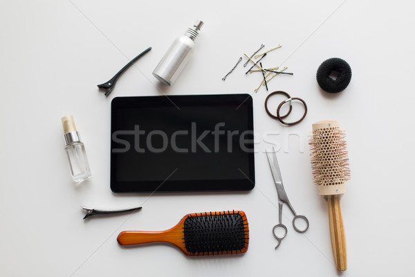 tablet pc, scissors, brushes and other hair tools Stock photo © dolgachov