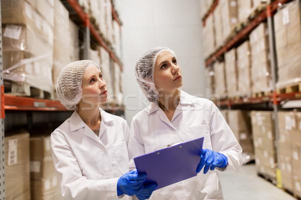 women technologists at ice cream factory warehouse Stock photo © dolgachov