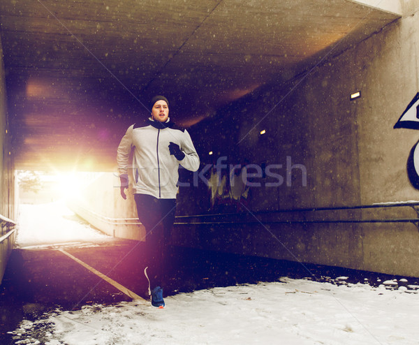 man running along subway tunnel in winter Stock photo © dolgachov
