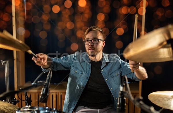 музыканта играет барабан концерта фары Сток-фото © dolgachov