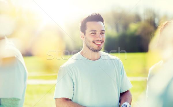 幸せ 男 公園 志願 チャリティー ストックフォト © dolgachov