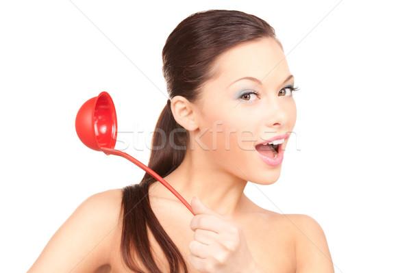 Piękna gospodyni domowa czerwony chochla zdjęcie kobieta Zdjęcia stock © dolgachov