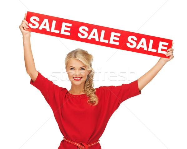 Kadın kırmızı elbise satış imzalamak resim mutlu Stok fotoğraf © dolgachov