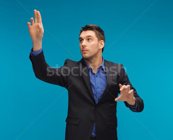 Homme costume travail quelque chose imaginaire photos Photo stock © dolgachov