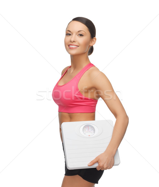 woman with scale Stock photo © dolgachov