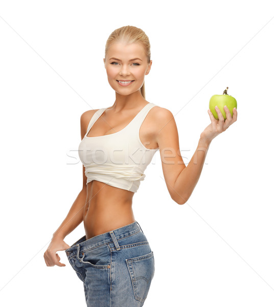 sporty woman showing big pants Stock photo © dolgachov