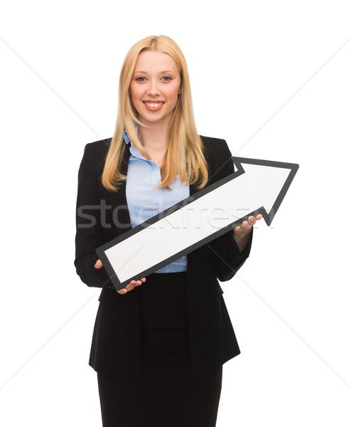smiling businesswoman with direction arrow sign Stock photo © dolgachov