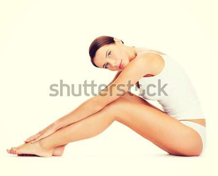 Stock photo: woman in cotton underwear doing exercises