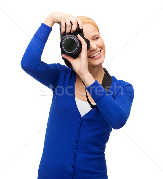 Donna sorridente foto fotocamera digitale moderno tecnologia Foto d'archivio © dolgachov