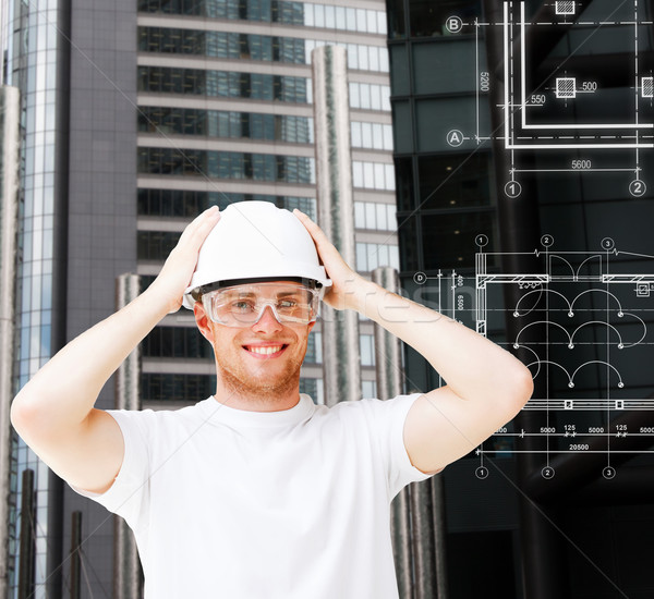 male architect in white helmet with safety glasses Stock photo © dolgachov