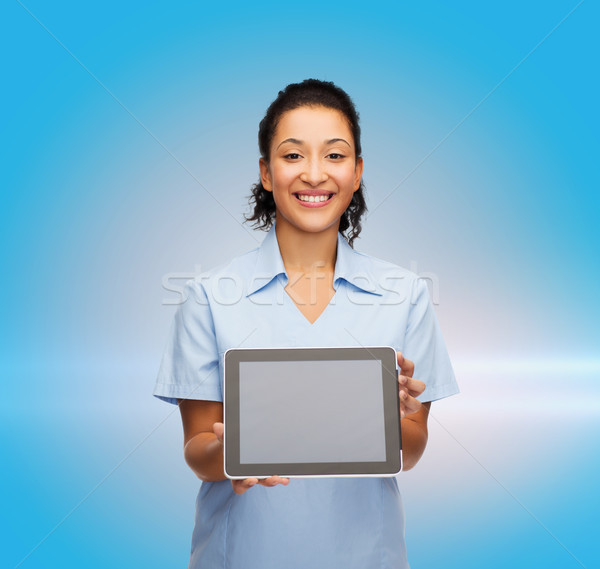 smiling female doctor or nurse with tablet pc Stock photo © dolgachov