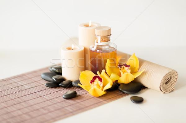 Masaje piedras orquídeas flor spa Foto stock © dolgachov