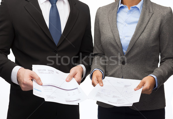businesswoman and businessman with files and forms Stock photo © dolgachov