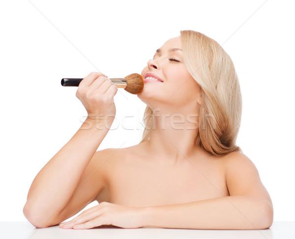 beautiful woman with closed eyes and makeup brush Stock photo © dolgachov