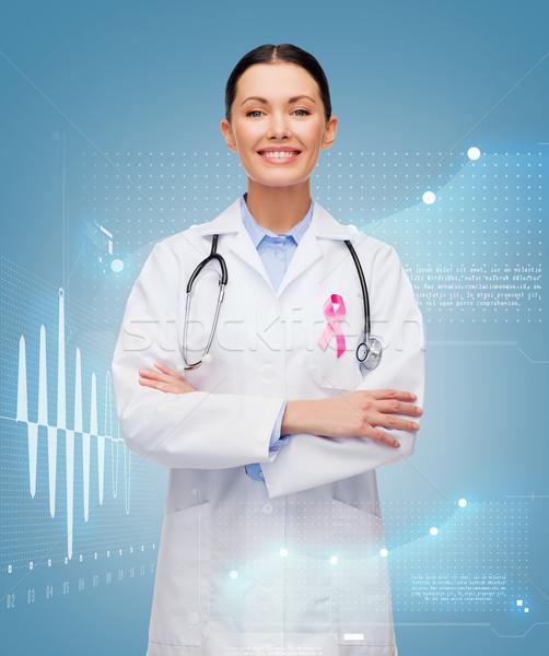 doctor with stethoscope, cancer awareness ribbon Stock photo © dolgachov