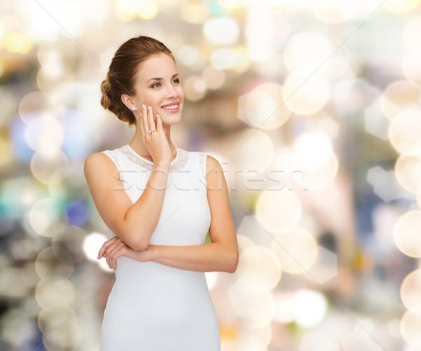 Uśmiechnięta kobieta biała sukienka pierścionek z brylantem wakacje uroczystości Zdjęcia stock © dolgachov