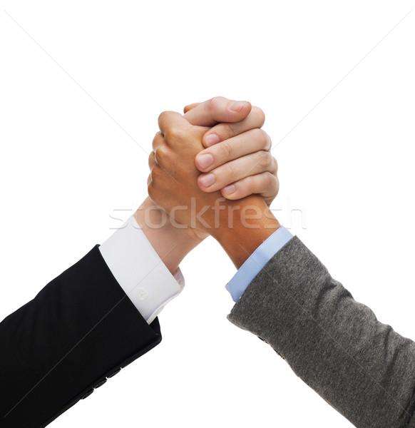 Eller iki kişi iş rekabet adam kadın Stok fotoğraf © dolgachov