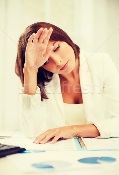bored and tired woman with documents Stock photo © dolgachov