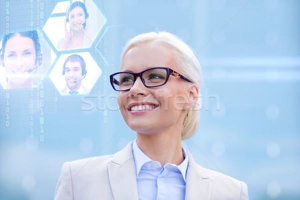 小さな 笑みを浮かべて 女性実業家 眼鏡 屋外 ビジネスの方々 ストックフォト © dolgachov