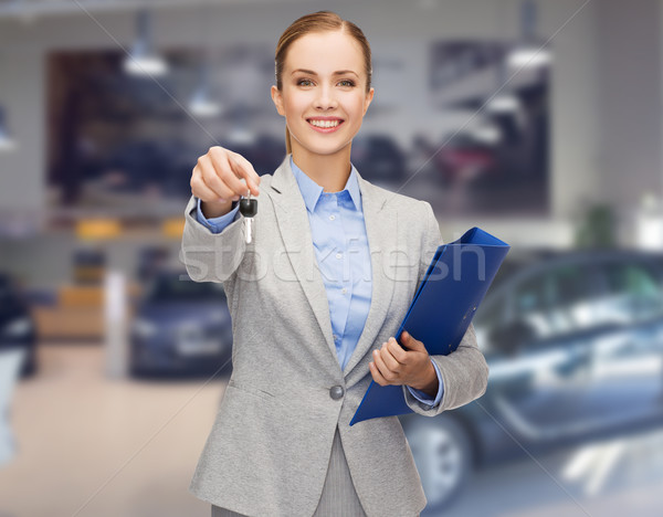 businesswoman or saleswoman giving car key Stock photo © dolgachov