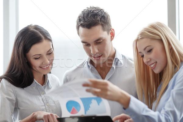 ビジネスチーム 見える クリップボード ビジネス オフィス 笑みを浮かべて ストックフォト © dolgachov