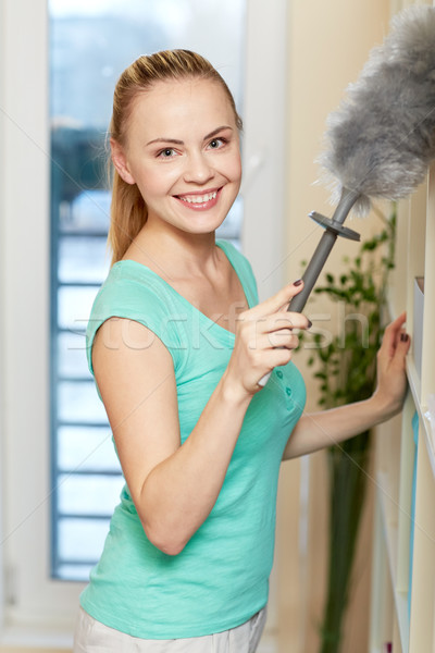 happy woman with duster cleaning at home Stock photo © dolgachov