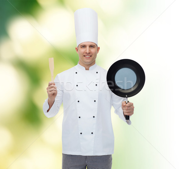 Stock photo: happy male chef holding frying pan and spatula