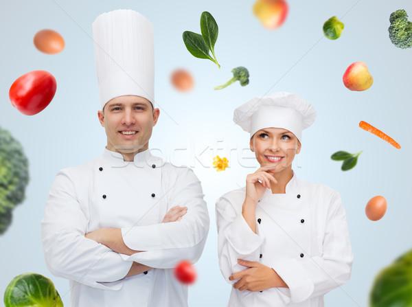 Boldog szakács pár étel főzés hivatás Stock fotó © dolgachov