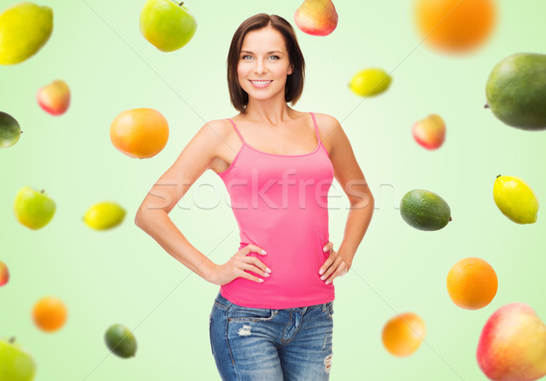 Vrouw roze tank top vruchten groene Stockfoto © dolgachov