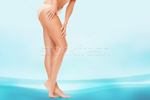 woman in cotton panties touching her legs Stock photo © dolgachov