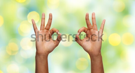 hands showing ok sign over rainbow background Stock photo © dolgachov