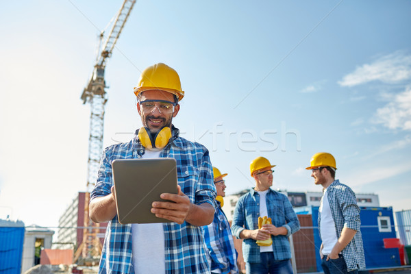 Bouwer veiligheidshelm bouw business gebouw Stockfoto © dolgachov