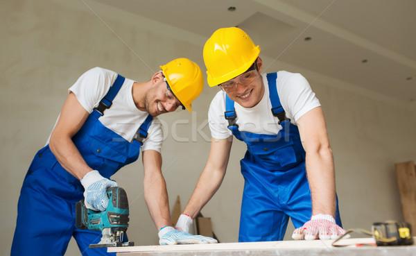 Grupo constructores herramientas negocios edificio Foto stock © dolgachov