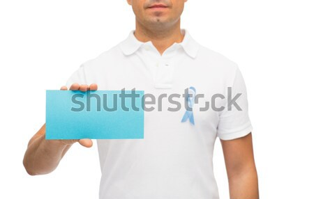 man with prostate cancer awareness ribbon and card Stock photo © dolgachov