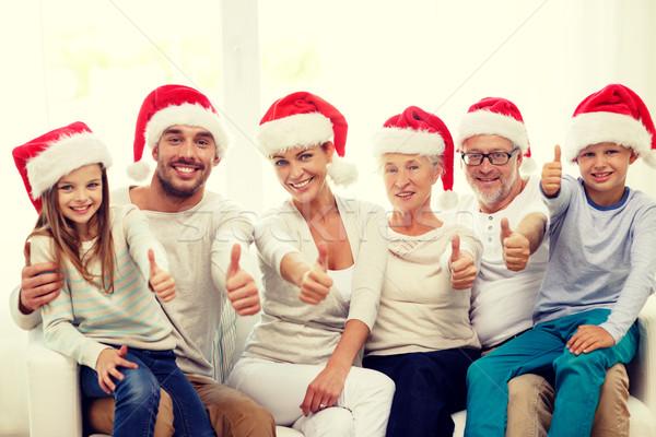 ストックフォト: 幸せな家族 · 座って · ソファ · ホーム · 家族 · 幸福
