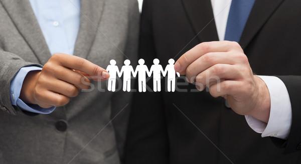 Geschäftsmann Geschäftsfrau halten Papier Team Business Stock foto © dolgachov